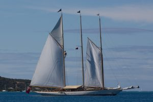Raising the sails on a Classic Yacht Charter
