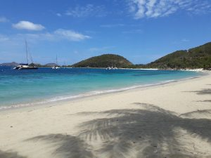 Relax on a tropical beach on a BVI Crewed Yacht Charter